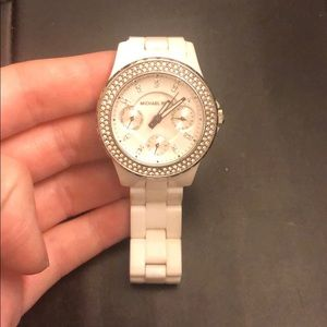 White Michael Kors watch.